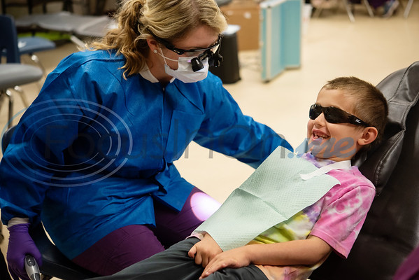 Tyler Junior College Dental Studies student Shelby Hailey gives preventative dental care to kindergartener Abel Cornelius, 6, at Jack Elementary School on Monday April 29, 2019.  (Sarah A. Miller/Tyler Morning Telegraph)