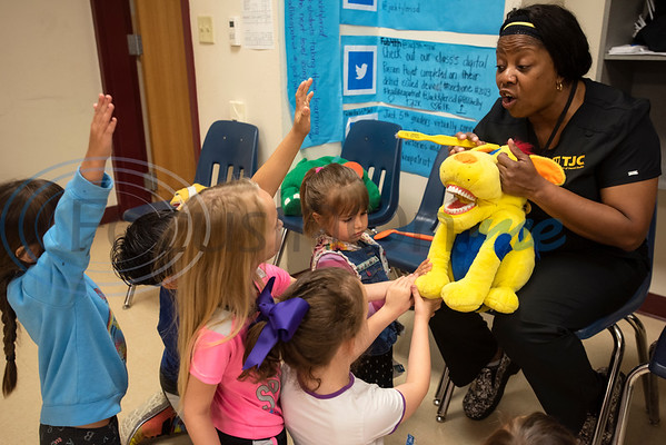 Tyler Junior College professor Regina Weems talks about dental hygiene to a group of kindergarteners using a stuffed animal with teeth at Jack Elementary School on Monday April 29, 2019.  (Sarah A. Miller/Tyler Morning Telegraph)