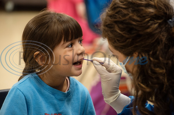 Tyler Junior College Dental Studies student Rachel Leake gives kindergartener Harper Hajek, 6, a fluoride treatment at Jack Elementary School on Monday April 29, 2019.  (Sarah A. Miller/Tyler Morning Telegraph)