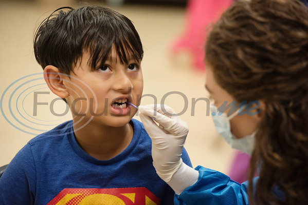 Tyler Junior College Dental Studies student Rachel Leake gives kindergartener Hridesh Thapa, 6, a fluoride treatment at Jack Elementary School on Monday April 29, 2019.  (Sarah A. Miller/Tyler Morning Telegraph)