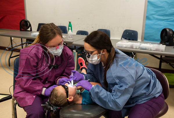 Tyler Junior College Dental Studies students Sierra Collins and Emily Herbertson give preventative dental care to first grader Annalee Sikes, 7, at Jack Elementary School on Monday April 29, 2019.  (Sarah A. Miller/Tyler Morning Telegraph)