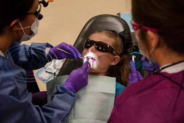 Tyler Junior College Dental Studies students Emily Herbertson and Sierra Collins give preventative dental care to first grader Annalee Sikes, 7, at Jack Elementary School on Monday April 29, 2019.  (Sarah A. Miller/Tyler Morning Telegraph)