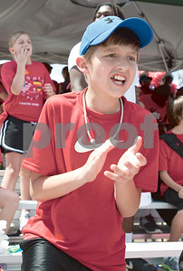 photo by Sarah A. Miller/Tyler Morning Telegraph  Andy Woods Elementary fifth grader Jacob Stjernstrom, 11, cheers for his classmates running the 1600 meter elay Tuesday at John Tyler High School. Andy Woods was one of four Tyler ISD schools whose fifth graders participated in track and field day.