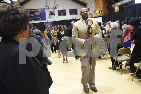 Dr. Robert Harper, assistant to the Vice President of Academic Affairs, leads the procession carrying the Texas College mace during the building dedication service to commemorate the competition Phase 1 of the Texas College Master Plan Building Project Thursday April 7, 2016.  (Sarah A. Miller/Tyler Morning Telegraph)