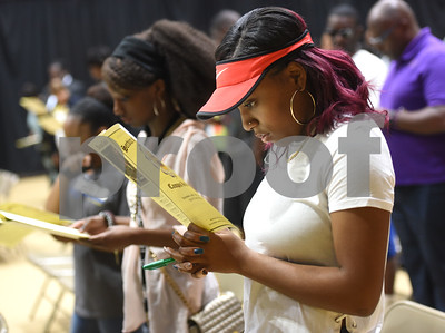 Texas College Desirae Bennett of Dallas reads along with the Litany of Dedication and Blessing during the building dedication service to commemorate the competition Phase 1 of the Texas College Master Plan Building Project Thursday April 7, 2016.  (Sarah A. Miller/Tyler Morning Telegraph)