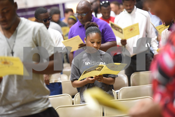 Texas College students and stuff read along with the Litany of Dedication and Blessing during the building dedication service to commemorate the competition Phase 1 of the Texas College Master Plan Building Project Thursday April 7, 2016.  (Sarah A. Miller/Tyler Morning Telegraph)