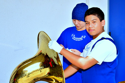 ray staying cool as usual even though is hand is stuck in his tuba. :)