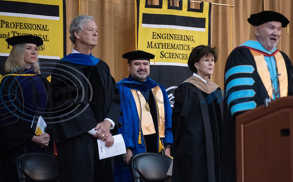 Tyler Junior College President for Branch Locations and District Provost Juan Mejia, center, is announced as the finalist to become the next Chancellor at the commencement ceremony for Engineering, Math & Science departments plus all Early College graduates on Friday May 10, 2019.  (Sarah A. Miller/Tyler Morning Telegraph)