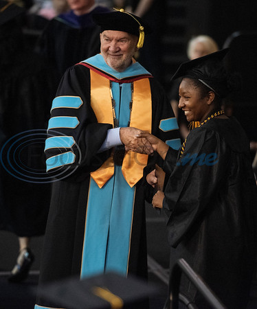 Tyler Junior College Chancellor and CEO Mike Metke shakes hands with Early College High School graduate Mackenzie Wade as she receives her associates degree at the commencement ceremony for Engineering, Math & Science departments plus all Early College graduates on Friday May 10, 2019. This was the first class of Early College High School graduates.  (Sarah A. Miller/Tyler Morning Telegraph)
