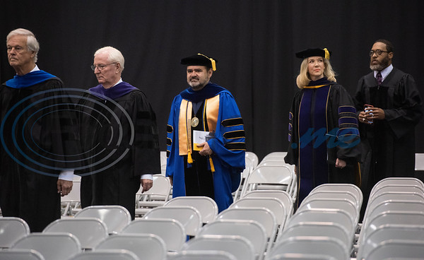 Tyler Junior College President for Branch Locations and District Provost Juan Mejia, center, walks in with the Board of Trustees and other distinguished guest at the commencement ceremony for Engineering, Math & Science departments plus all Early College graduates on Friday May 10, 2019.  (Sarah A. Miller/Tyler Morning Telegraph)