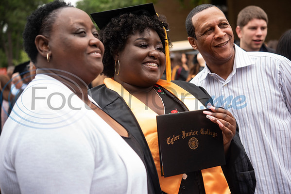 Tyler Junior College Brittany Boakye takes a photo with her mom Maxine Williams and her dad Phillip Evans of Grand Prairie after the commencement ceremony for Engineering, Math & Science departments plus all Early College graduates on Friday May 10, 2019.   (Sarah A. Miller/Tyler Morning Telegraph)