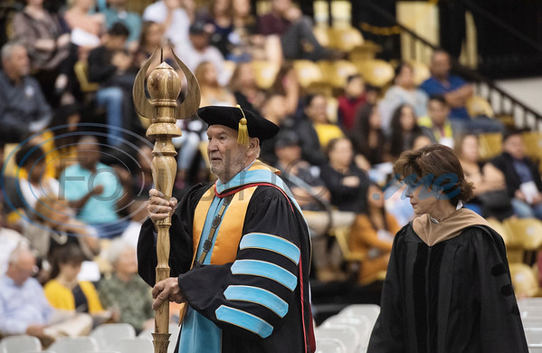 Tyler Junior College Chancellor and CEO Mike Metke carries a staff to start the commencement ceremony for Engineering, Math & Science departments plus all Early College graduates on Friday May 10, 2019. Pictured with him is Trustee Ann W. Brookshire.   (Sarah A. Miller/Tyler Morning Telegraph)