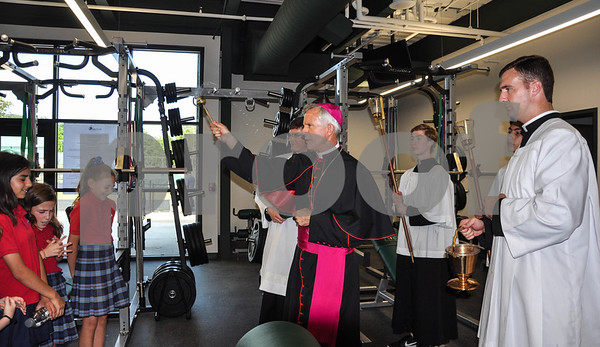 Bishop Joseph Strickland gives a final blessing in the weight room of Thomas K. Gorman's new athletic center, the Brodnax Family Crusader Center. The Blessing and Dedication took place on Friday, May 11. (Jessica T. Payne/Tyler Paper)