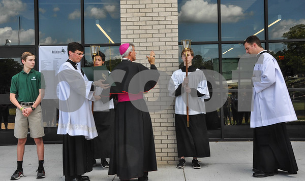Bishop Joseph Strickland blesses the new Brodnax Family Crusader Center during the Blessing and Dedication on the Thomas K. Gorman Catholic School campus on Friday, May 11. (Jessica T. Payne/Tyler Paper)