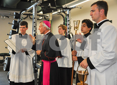 Bishop Joseph Strickland ends the Blessing and Dedication of Thomas K. Gorman's new Brodnax Family Crusader Center with a final blessing in the building's weight room. The Blessing and Dedication took place on Friday, May 11. (Jessica T. Payne/Tyler Paper)