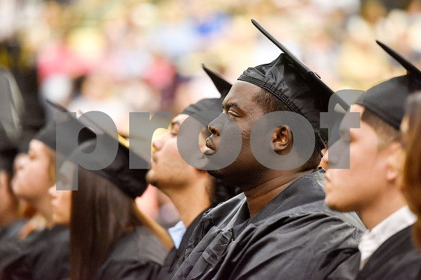 Brandon Cole, second from right, sits and listens during Tyler Junior College's spring commencement at Tyler Junior College in Tyler, Texas, on Friday, May 11, 2018. (Chelsea Purgahn/Tyler Morning Telegraph)