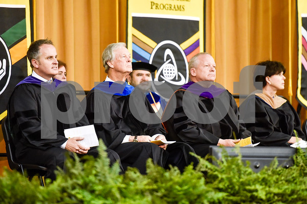 State Senator Bryan Hughes, left, sits with others on stage during Tyler Junior College's spring commencement at Tyler Junior College in Tyler, Texas, on Friday, May 11, 2018. (Chelsea Purgahn/Tyler Morning Telegraph)