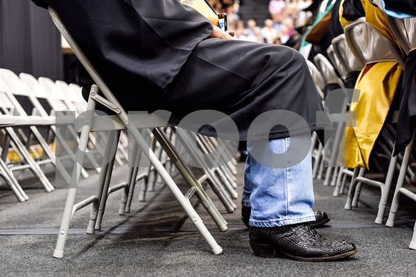 BJ Williams sits and listens during Tyler Junior College's spring commencement at Tyler Junior College in Tyler, Texas, on Friday, May 11, 2018. (Chelsea Purgahn/Tyler Morning Telegraph)