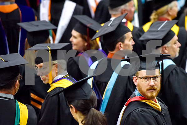 A faculty member watches as the graduates proceed to their seats during Tyler Junior College's commencement at Wagstaff Gymnasium in Tyler, Texas, on Friday, May 12, 2017. 1,141 students graduated in three different ceremonies. (Chelsea Purgahn/Tyler Morning Telegraph)