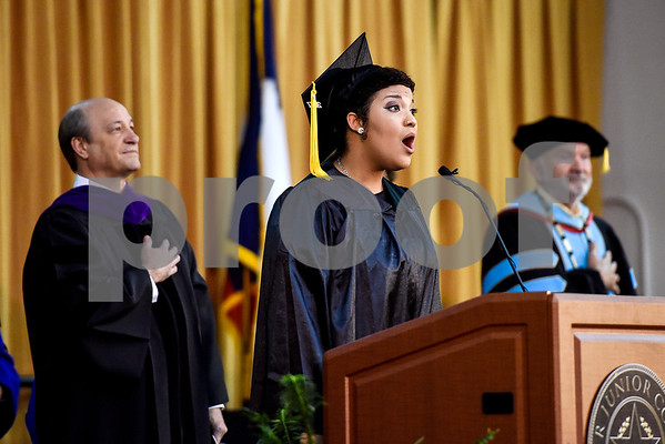 Jillian Brandon sings the national anthem during Tyler Junior College's commencement at Wagstaff Gymnasium in Tyler, Texas, on Friday, May 12, 2017. 1,141 students graduated in three different ceremonies. (Chelsea Purgahn/Tyler Morning Telegraph)