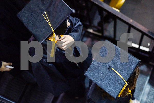 Graduates walk down stairs to their seats during Tyler Junior College's commencement at Wagstaff Gymnasium in Tyler, Texas, on Friday, May 12, 2017. 1,141 students graduated in three different ceremonies. (Chelsea Purgahn/Tyler Morning Telegraph)