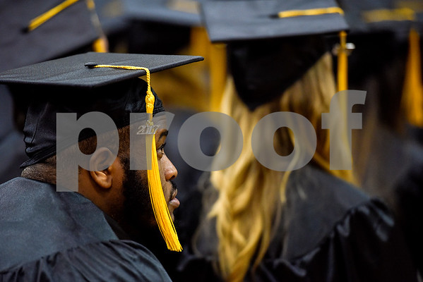 Darrell Henderson Jr. watches as other graduates proceed to the stage during Tyler Junior College's commencement at Wagstaff Gymnasium in Tyler, Texas, on Friday, May 12, 2017. 1,141 students graduated in three different ceremonies. (Chelsea Purgahn/Tyler Morning Telegraph)