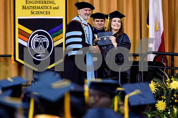 Tyler Junior College President Dr. Michael Metke poses for a photo with a graduate during Tyler Junior College's commencement at Wagstaff Gymnasium in Tyler, Texas, on Friday, May 12, 2017. 1,141 students graduated in three different ceremonies. (Chelsea Purgahn/Tyler Morning Telegraph)