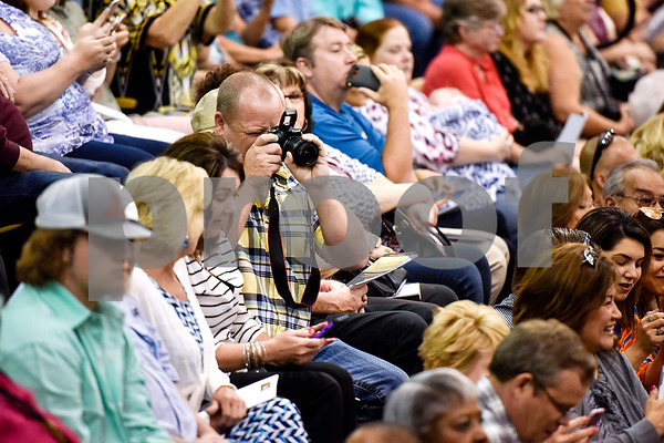 A man takes a photo of the graduates during Tyler Junior College's commencement at Wagstaff Gymnasium in Tyler, Texas, on Friday, May 12, 2017. 1,141 students graduated in three different ceremonies. (Chelsea Purgahn/Tyler Morning Telegraph)