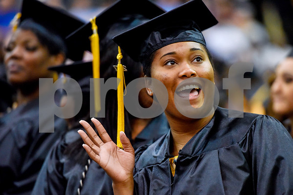 A graduate waves to friends and family during Tyler Junior College's commencement at Wagstaff Gymnasium in Tyler, Texas, on Friday, May 12, 2017. 1,141 students graduated in three different ceremonies. (Chelsea Purgahn/Tyler Morning Telegraph)