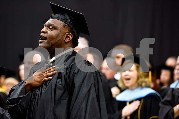 Deauntre Zantwain Alex sings the national anthem with other graduates and faculty during Tyler Junior College's commencement at Wagstaff Gymnasium in Tyler, Texas, on Friday, May 12, 2017. 1,141 students graduated in three different ceremonies. (Chelsea Purgahn/Tyler Morning Telegraph)