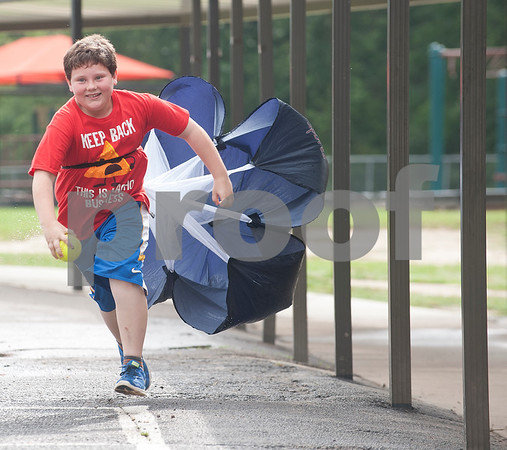 Mineola Elementary School fifth grader Layne Crump, 11, experiences drag, or air resistance, as he runs with a parachute on his back during the Science Extravaganza Friday May 15, 2015. Mineola High School students ran the event which had many different hands-on science experiment and demonstration booths for second through fifth graders to learn about. The projects included slingshots, microscopes, lasers, giant bubbles, chemical reactions and more.   (photo by Sarah A. Miller/Tyler Morning Telegraph)