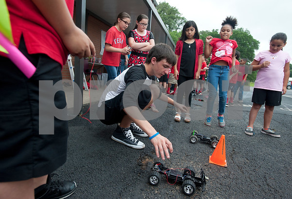 Mineola High School students held over 40 different hands-on science experiments and demonstrations for second through fifth graders. The projects included slingshots, microscopes, lasers, giant bubbles, chemical reactions and more.   (photo by Sarah A. Miller/Tyler Morning Telegraph)
