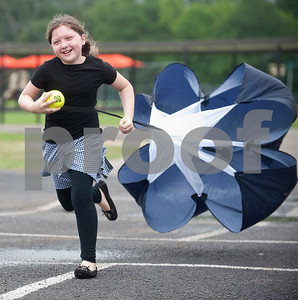 Mineola Elementary School second grader Aubrey Pilburn, 8, experiences drag, or air resistance, as she runs with a parachute on her back during the Science Extravaganza Friday May 15, 2015. Mineola High School students ran the event which had many different hands-on science experiment and demonstration booths for second through fifth graders to learn about. The projects included slingshots, microscopes, lasers, giant bubbles, chemical reactions and more.   (photo by Sarah A. Miller/Tyler Morning Telegraph)