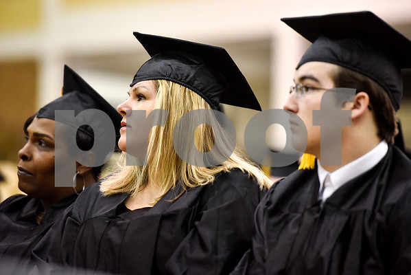 Graduates listen during a GED graduation ceremony at Wagstaff Gymnasium in Tyler, Texas, on Tuesday, May 16, 2017. Sixty-eight adult students walked the stage, with around 150 students total completing the program this year through Literacy Council of Tyler. (Chelsea Purgahn/Tyler Morning Telegraph)