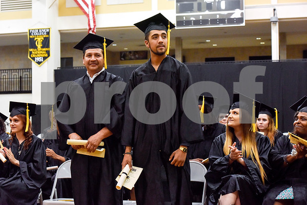 Father and son Edmundo and Levi Fuentes are recognized during a GED graduation ceremony at Wagstaff Gymnasium in Tyler, Texas, on Tuesday, May 16, 2017. Sixty-eight adult students walked the stage, with around 150 students total completing the program this year through Literacy Council of Tyler. (Chelsea Purgahn/Tyler Morning Telegraph)