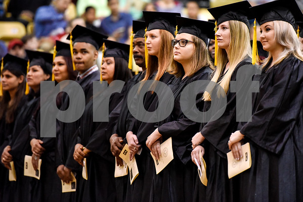 Graduates stand during a GED graduation ceremony at Wagstaff Gymnasium in Tyler, Texas, on Tuesday, May 16, 2017. Sixty-eight adult students walked the stage, with around 150 students total completing the program this year through Literacy Council of Tyler. (Chelsea Purgahn/Tyler Morning Telegraph)