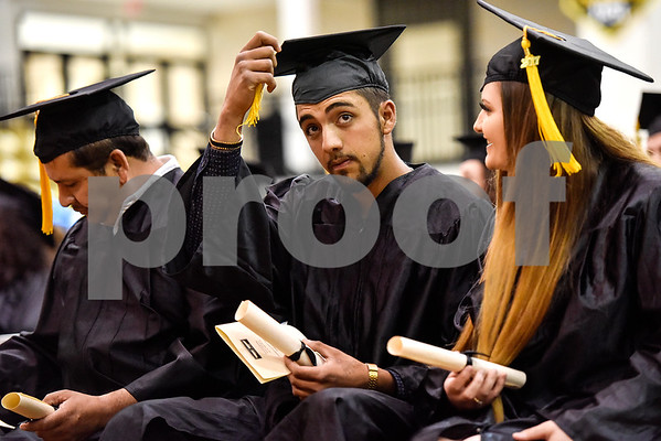 Levi Fuentes moves his tassel after walking the stage during a GED graduation ceremony at Wagstaff Gymnasium in Tyler, Texas, on Tuesday, May 16, 2017. Sixty-eight adult students walked the stage, with around 150 students total completing the program this year through Literacy Council of Tyler. (Chelsea Purgahn/Tyler Morning Telegraph)