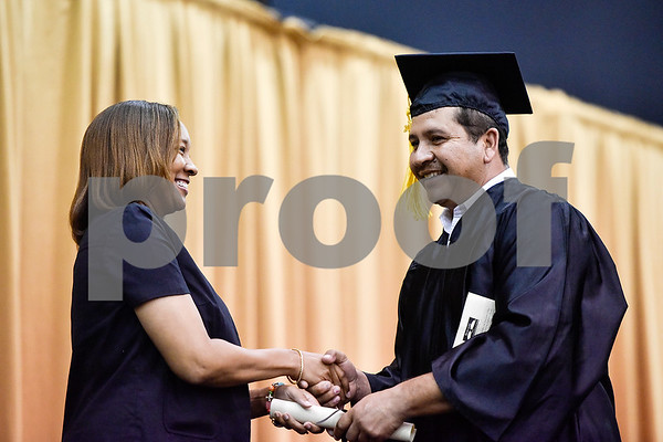Edmundo Fuentes smiles as he receives his diploma during a GED graduation ceremony at Wagstaff Gymnasium in Tyler, Texas, on Tuesday, May 16, 2017. Sixty-eight adult students walked the stage, with around 150 students total completing the program this year through Literacy Council of Tyler. (Chelsea Purgahn/Tyler Morning Telegraph)