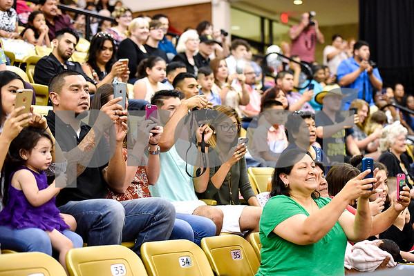 Friends and family take photographs during a GED graduation ceremony at Wagstaff Gymnasium in Tyler, Texas, on Tuesday, May 16, 2017. Sixty-eight adult students walked the stage, with around 150 students total completing the program this year through Literacy Council of Tyler. (Chelsea Purgahn/Tyler Morning Telegraph)