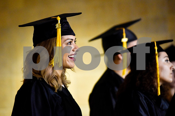 Yusmine Villegas smiles during a GED graduation ceremony at Wagstaff Gymnasium in Tyler, Texas, on Tuesday, May 16, 2017. Sixty-eight adult students walked the stage, with around 150 students total completing the program this year through Literacy Council of Tyler. (Chelsea Purgahn/Tyler Morning Telegraph)