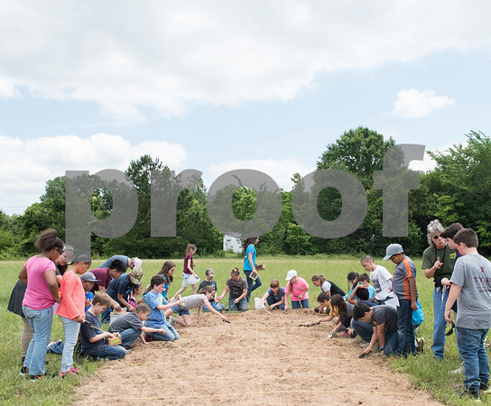 Tyler Classical Academy fourth graders excavate objects hidden as part of an archaeology dig at Camp Tyler Tuesday May 16, 2017. The objects represented Native American tribes from the Northwest region of the United States, which the students studied prior to the dig.  (Sarah A. Miller/Tyler Morning Telegraph)