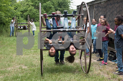 Tyler Classical Academy fourth graders Rebecca Dong and Avianna Castro ride on a wheel at Camp Tyler Tuesday May 16, 2017.   (Sarah A. Miller/Tyler Morning Telegraph)