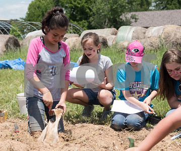 Tyler Classical Academy fourth grader Victoria Chaparro  excavates an object hidden in the ground as part of an archaeology dig at Camp Tyler Tuesday May 16, 2017. The objects represented Native American tribes from the Northwest region of the United States, which the students studied prior to the dig.  (Sarah A. Miller/Tyler Morning Telegraph)