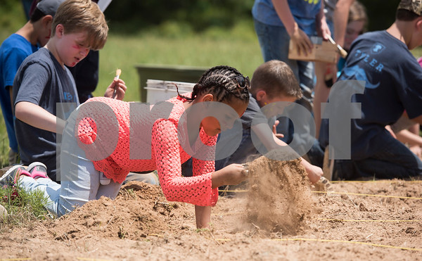 Tyler Classical Academy student Kyeasha Crenshaw uses a shovel to look through the dirt for objects hidden as part of an archaeology dig at Camp Tyler Tuesday May 16, 2017. The objects represented Native American tribes from the Northwest region of the United States, which the students studied prior to the dig.  (Sarah A. Miller/Tyler Morning Telegraph)