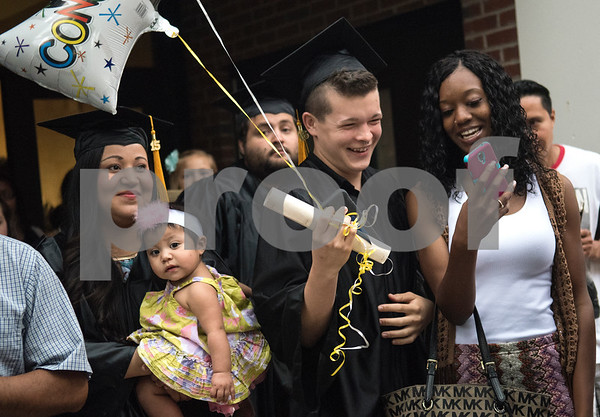 Graduates celebrate with friends and family after the General Educational Development Commencement ceremony held Tuesday May 17, 2016 at Tyler Junior College's Wagstaff Gymnasium. The Literacy Council of Tyler, in partnership with TJC, provides GED preparation studies and pre-testing; English as a Second Language (ESL) and other programs.   (Sarah A. Miller/Tyler Morning Telegraph)