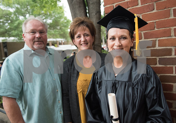 Graduate Geana Vivian is pictured with Pastor Greg Fleck and Pastor Lisa Fleck after the General Educational Development Commencement ceremony held Tuesday May 17, 2016 at Tyler Junior College's Wagstaff Gymnasium. The Literacy Council of Tyler, in partnership with TJC, provides GED preparation studies and pre-testing; English as a Second Language (ESL) and other programs.   (Sarah A. Miller/Tyler Morning Telegraph)