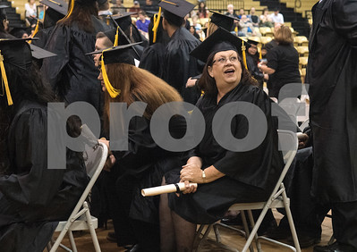 A graduate looks into the crowd during the General Educational Development Commencement ceremony held Tuesday May 17, 2016 at Tyler Junior College's Wagstaff Gymnasium. The Literacy Council of Tyler, in partnership with TJC, provides GED preparation studies and pre-testing; English as a Second Language (ESL) and other programs.   (Sarah A. Miller/Tyler Morning Telegraph)