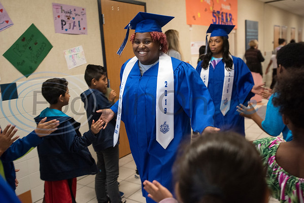 Students from the John Tyler High School Advancement Via Individual Determination (AVID) program wore their graduation caps and gowns for senior walks around the school's feeder campuses on Friday May 17, 2019.  (Sarah A. Miller/Tyler Morning Telegraph)