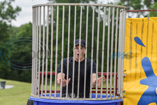 Rusk High School principal Scott Schwartz gets wet in the dunking booth at the Destination College: Family Fun Fest event on Saturday, May 18. The event was a fundraiser for the Carlene Clayton Memorial Scholarship and also included dodgeball tournaments, music, washer tournament and more. (Jessica T. Payne/Tyler Morning Telegraph)