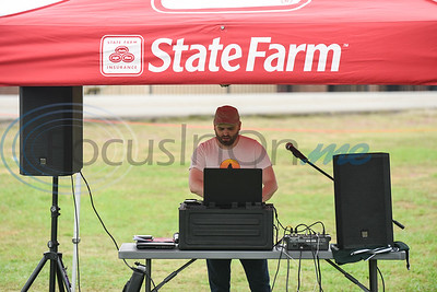 DJ Walker Waggonner of Boogie Butt Productions gets the crowd going at the Destination College: Family Fun Fest honoring Rusk ISD principal Carlene Clayton. The event was held at Rusk High School on Saturday, May 18 raising money for the Carlene Clayton Memorial Scholarship.  (Jessica T. Payne/Tyler Morning Telegraph)